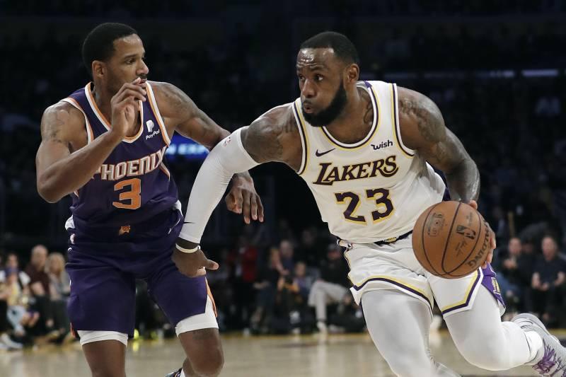 25a46ebc4d15 Los Angeles Lakers  LeBron James (23) dribbles next to Phoenix Suns  Trevor