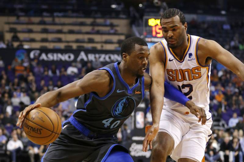 Dallas Mavericks forward Harrison Barnes drives on Phoenix Suns forward  T.J. Warren (12) in 7dc324a8e