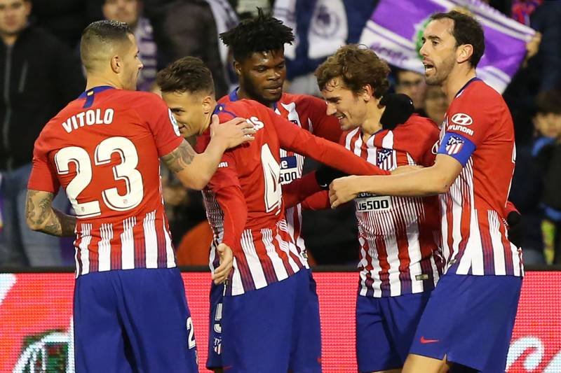da60d7f1e Atletico Madrid s French forward Antoine Griezmann (2ndR) celebrates with  teammates after scoring a goal