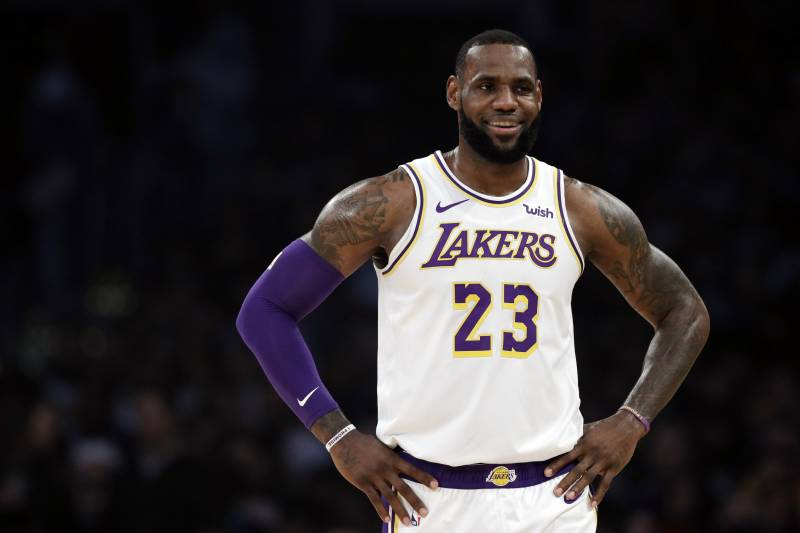 c1a3903051f2 Los Angeles Lakers  LeBron James (23) smiles during a break in action during
