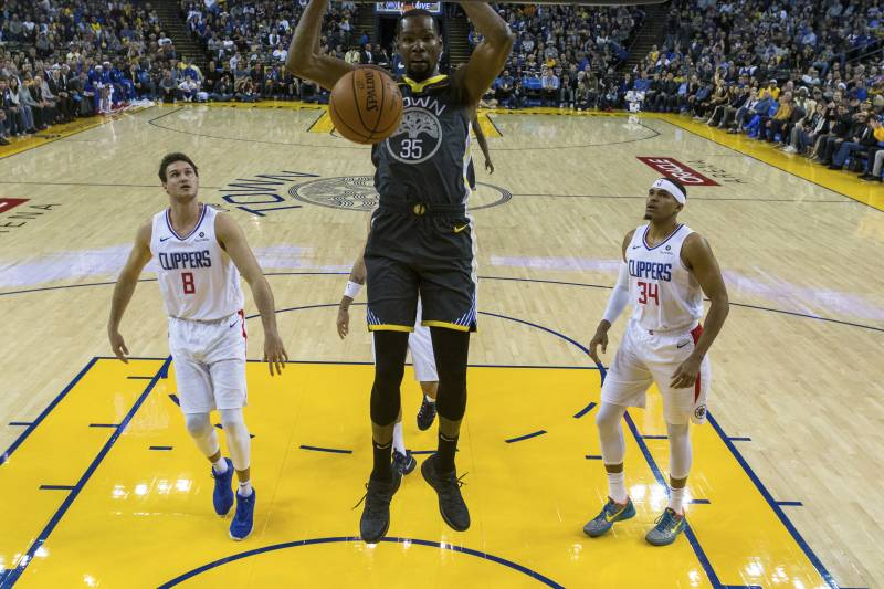 7ff991035c8a Golden State Warriors forward Kevin Durant (35) dunks the ball as Los  Angeles Clippers