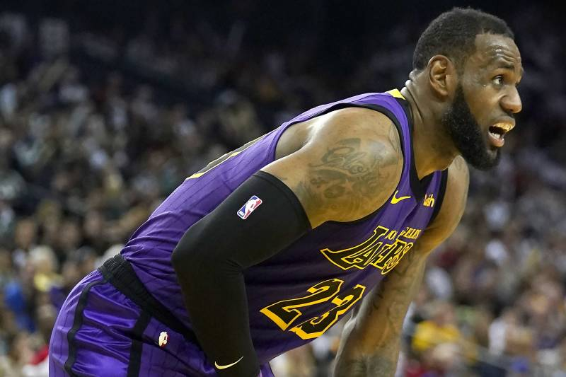 b104fa3fe24 Los Angeles Lakers forward LeBron James bends over after straining his  groin during the second half