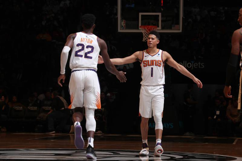 BROOKLYN, NY - DECEMBER 23: Devin Booker #1 and Deandre Ayton #22 of the Phoenix Suns high-five during a game against the Brooklyn Nets on December 23, 2018 at Barclays Center in Brooklyn, New York. NOTE TO USER: User expressly acknowledges and agrees that, by downloading and or using this Photograph, user is consenting to the terms and conditions of the Getty Images License Agreement. Mandatory Copyright Notice: Copyright 2018 NBAE (Photo by Nathaniel S. Butler/NBAE via Getty Images)