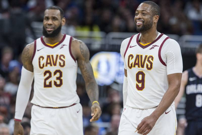 131e88bc779 Friends and teammates Cleveland Cavaliers forward LeBron James (23) and  Cleveland Cavaliers guard Dwyane