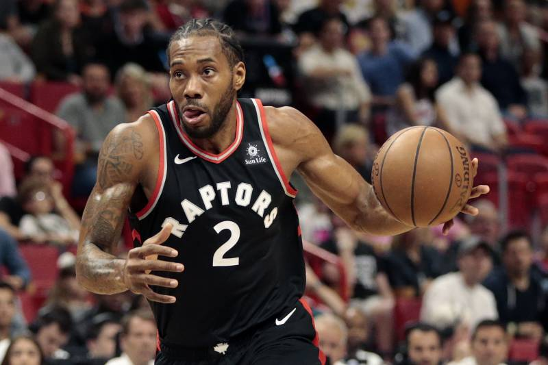 4e1c127a5 Toronto Raptors forward Kawhi Leonard (2) dribbles the ball against the  Miami Heat during