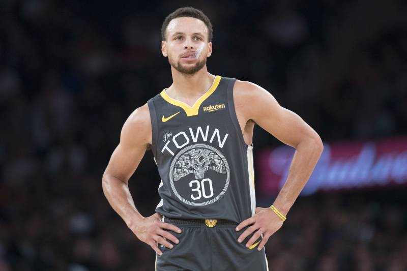 50938e40ced4 Golden State Warriors guard Stephen Curry pauses on the court during the  first half of an