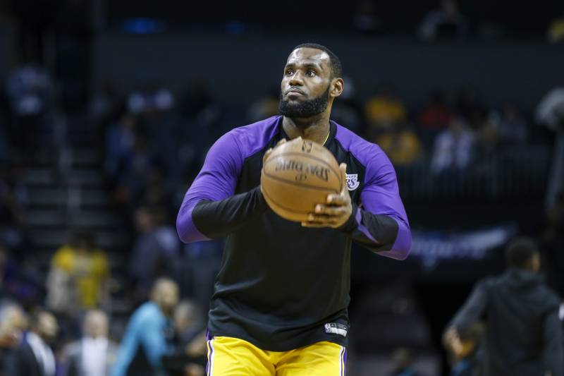 73f0482e1 Los Angeles Lakers forward LeBron James warms up during halftime as Los  Angeles plays the Charlotte