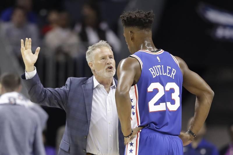 23a4a66429d23c Philadelphia 76ers head coach Brett Brown, left, talks with Jimmy Butler  (23)