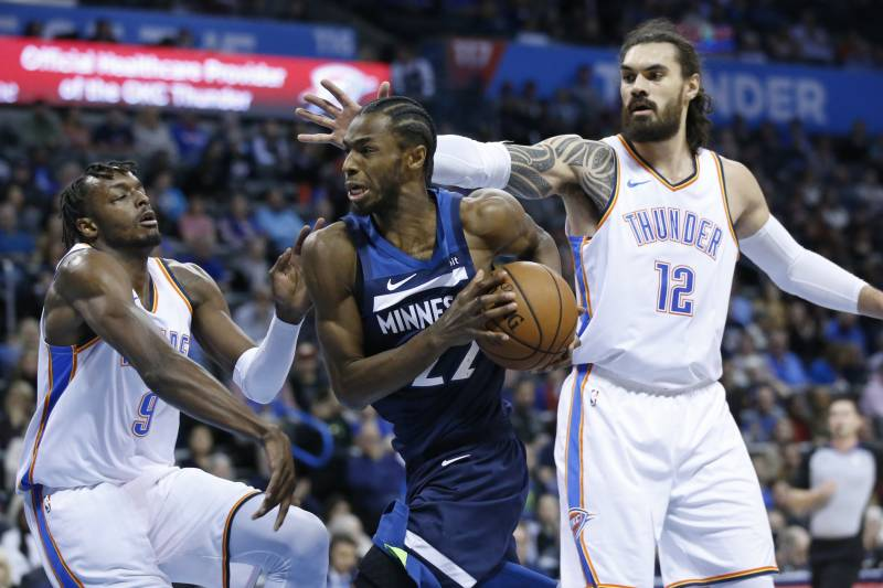 e13336de615 Minnesota Timberwolves forward Andrew Wiggins (22) drives between Oklahoma  City Thunder forward Jerami Grant