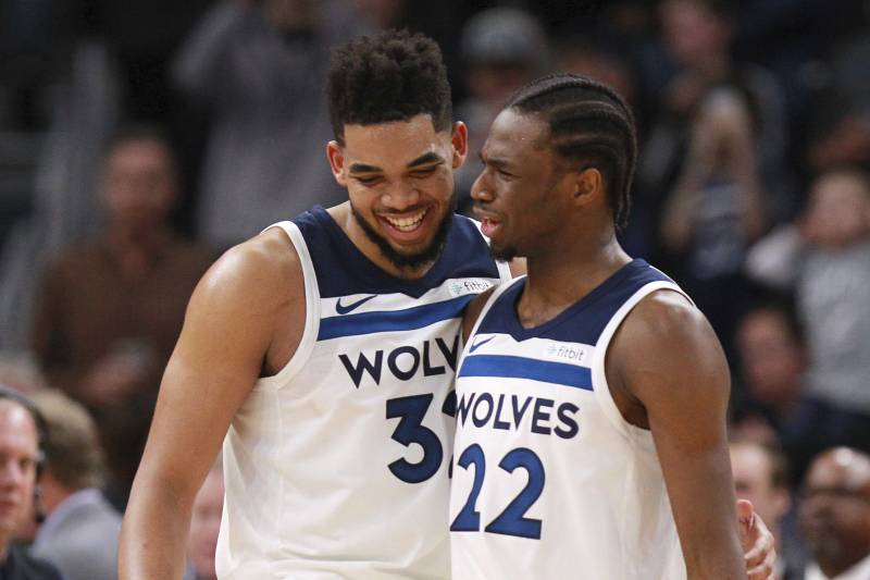 Minnesota Timberwolves forward Karl-Anthony Towns (32) is congratulated by  teammate Andrew Wiggins b7953e745