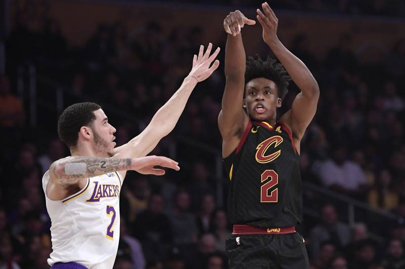 c724620e Cleveland Cavaliers guard Collin Sexton, right, shoots as Los Angeles  Lakers guard Lonzo Ball
