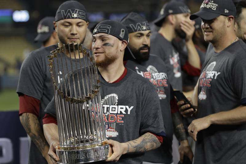 3dd3ec2057a Boston Red Sox catcher Christian Vazquez holds the championship trophy  after Game 5 of baseball s World