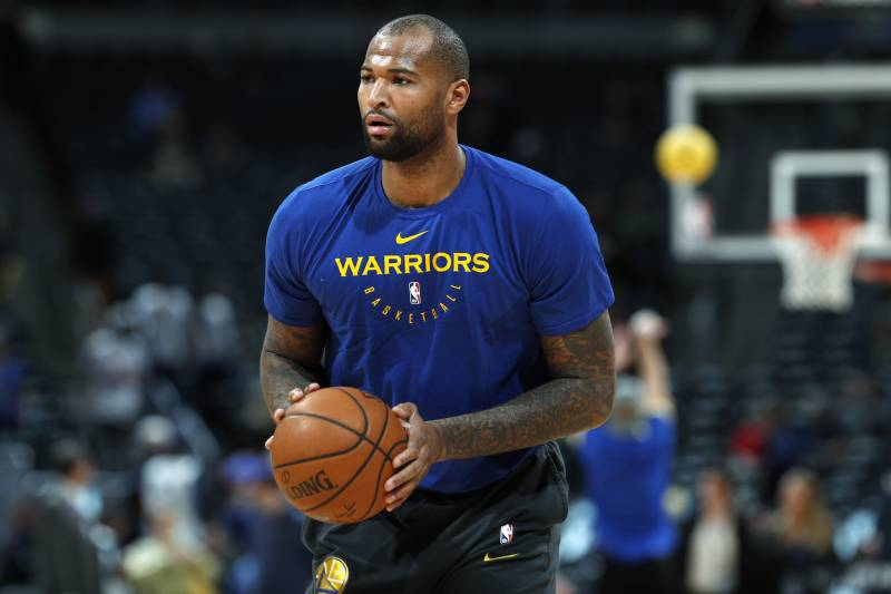 Injured Golden State Warriors center DeMarcus Cousins takes a shot as he  works out before the b3b460de8