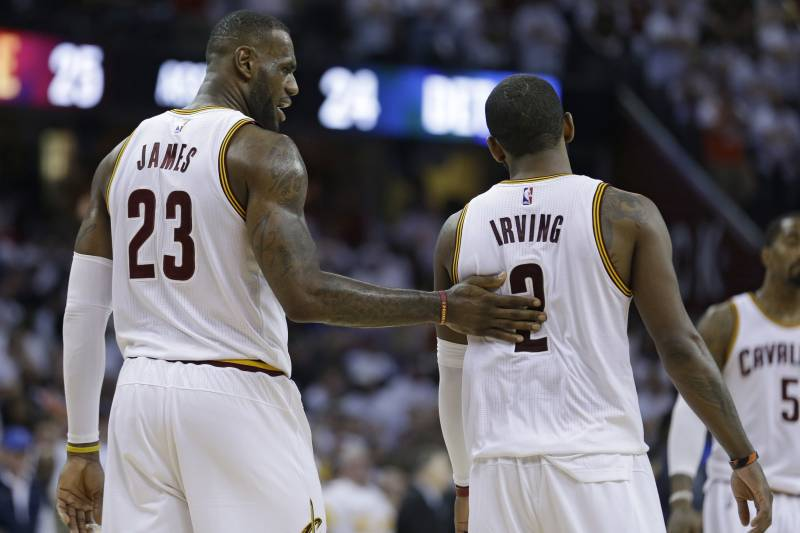 8c7f1f642 Cleveland Cavaliers  LeBron James (23) talks with Kyrie Irving (2) in