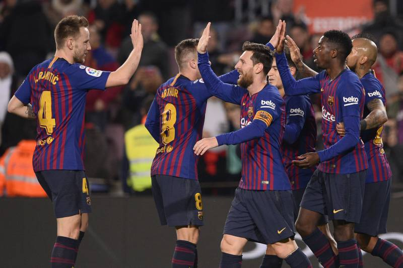 9f0c7c63e Barcelona's French forward Ousmane Dembele (2R) celebrates his second goal  with teammates during the
