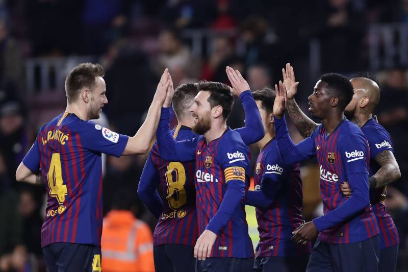 2bf6604c2b3 FC Barcelona's Dembele, right, celebrates after scoring with teammates his  side's second goal during