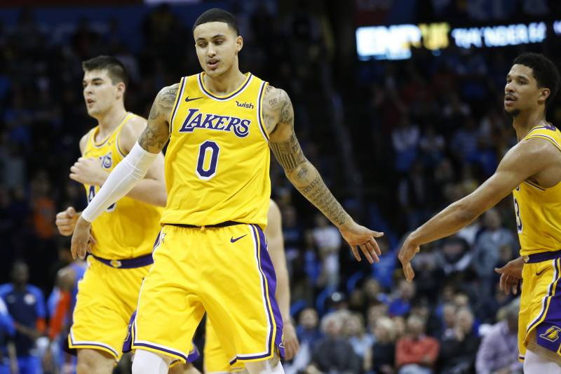 931996b9ede Los Angeles Lakers forward Kyle Kuzma (0) is congratulated by teammate Josh  Hart during