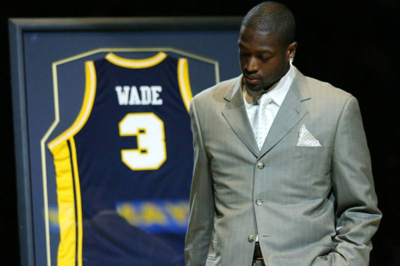 c3da3cf63fa Miami Heat and former Marquette player Dwyane Wade takes a moment during a  half time presentation