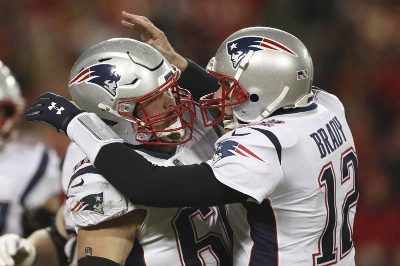b057068eaecf7 New England Patriots quarterback Tom Brady celebrates with center David  Andrews (60) after throwing
