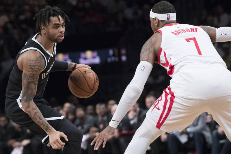 d7d5275ba34 Houston Rockets forward Carmelo Anthony (7) guards Brooklyn Nets guard  D Angelo Russell
