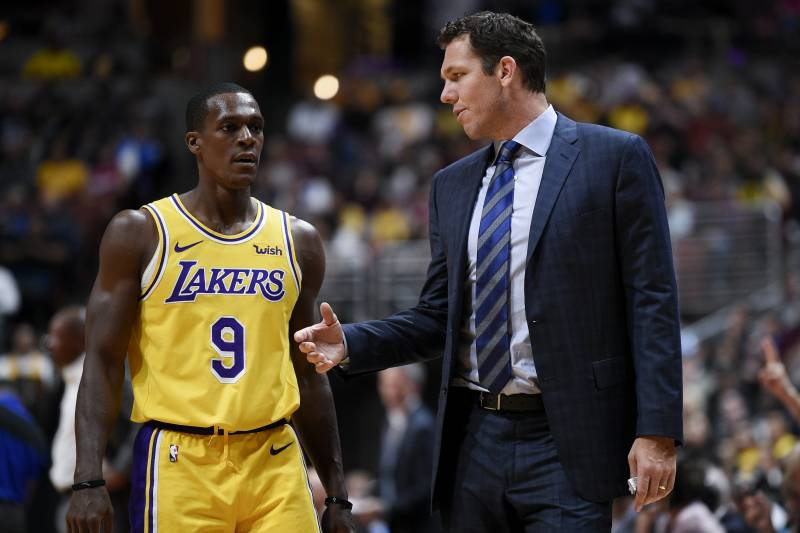 657a01fb867 Los Angeles Lakers head coach Luke Walton, right, speaks with guard Rajon  Rondo during
