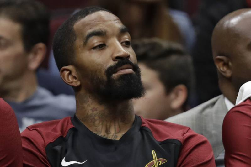 31550dbc84e4 Cleveland Cavaliers  JR Smith watches from the bench during the first half  of the team s