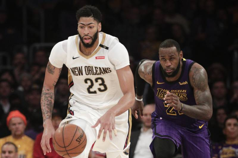 b876e8e0a New Orleans Pelicans  Anthony Davis dribbles the ball past Los Angeles  Lakers  LeBron James