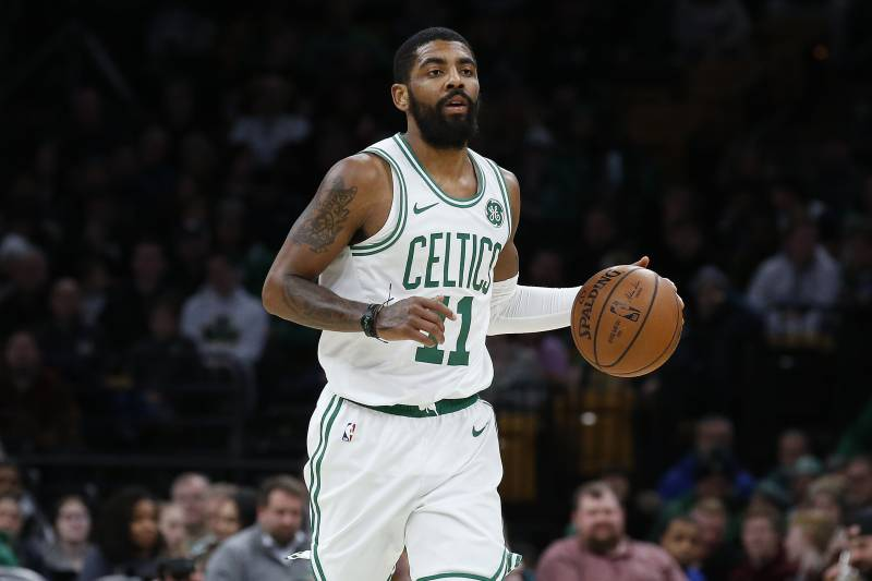 799d75411357 Boston Celtics  Kyrie Irving brings the ball up court during the second  quarter of an
