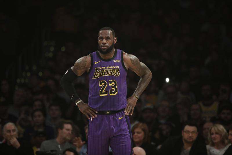 79f7f4495 Los Angeles Lakers  LeBron James stands on the court during the first half  of an