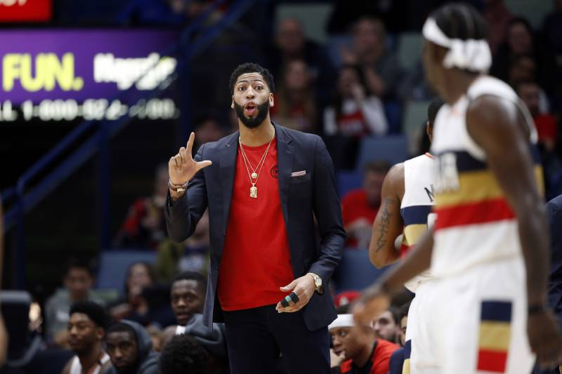 a3e7a3b60a5f New Orleans Pelicans forward Anthony Davis talks to guard Jrue Holiday