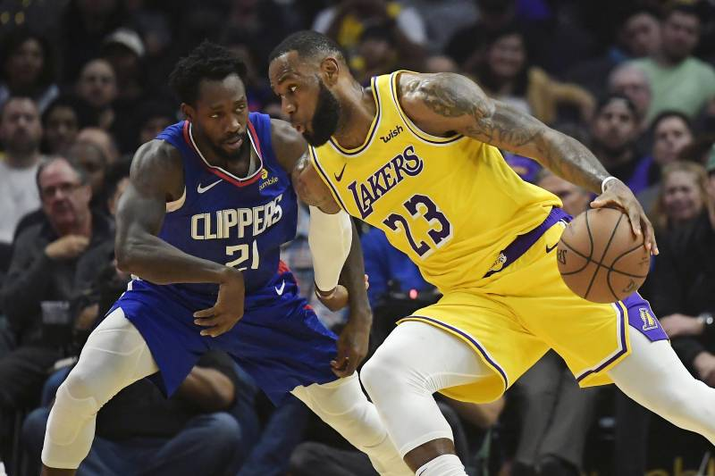 5566bffe055 LeBron James Scores 24 in Return from Groin Injury as Lakers Beat Clippers  in OT