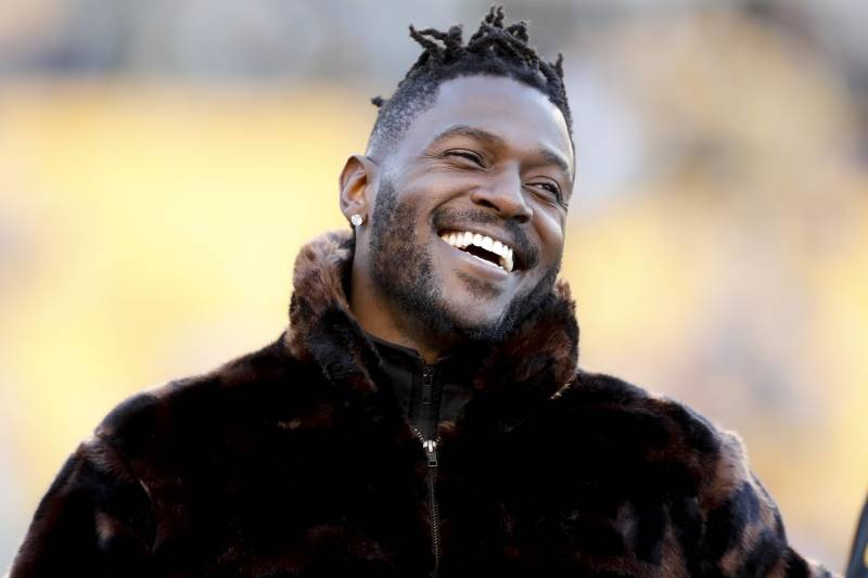 af4a23b49 Pittsburgh Steelers wide receiver Antonio Brown stands a long the sideline  in street clothes before an