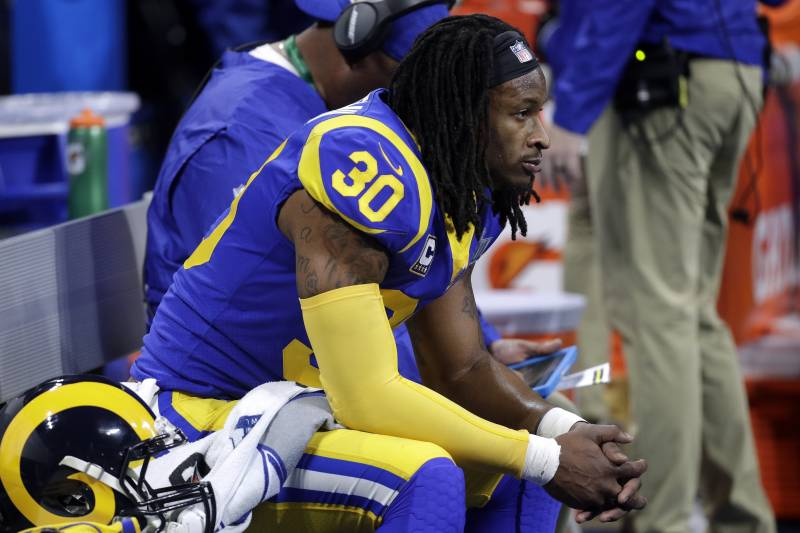0a0c9e4e233 Los Angeles Rams  Todd Gurley II watches from the bench during the first  half of