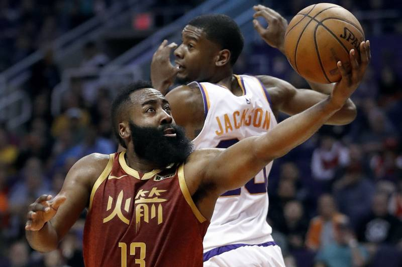 Houston Rockets guard James Harden (13) scores around Phoenix Suns forward  Josh Jackson ( 373f59d62