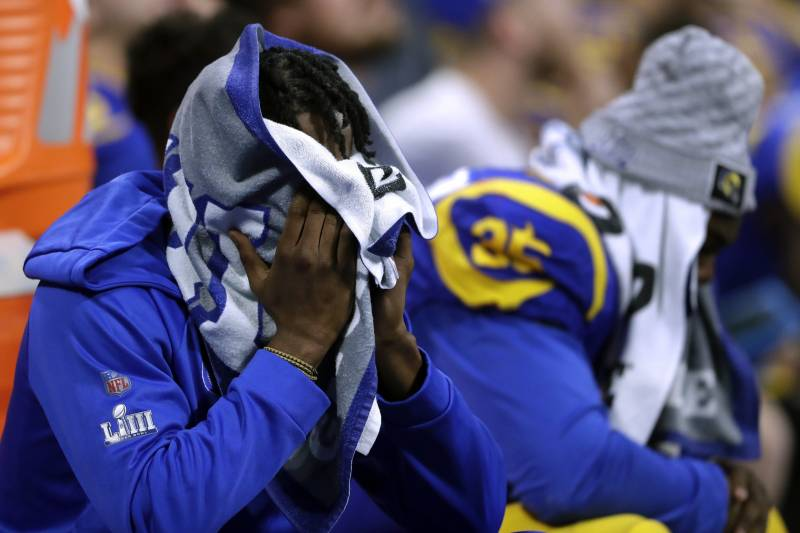 65c8ce0e9bd Los Angeles Rams players sit dejected on the bench during the second half  of the NFL