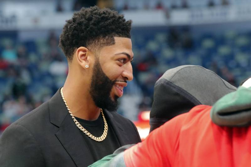 bd2ba45cc53 New Orleans Pelicans forward Anthony Davis huddles with teammates on the  court before an NBA basketball