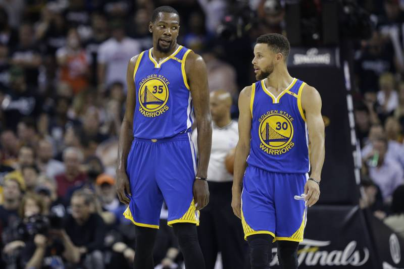 fcdeb7004c85 Golden State Warriors forward Kevin Durant (35) and Stephen Curry (30) talk