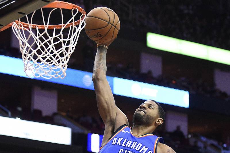 cae353f3cc2 Oklahoma City Thunder forward Paul George dunks during the first half of an  NBA basketball game