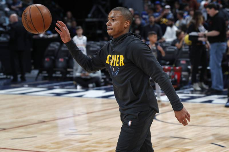 FILE - In this Monday, Fb. 11, 2019, file photo, Denver Nuggets guard Isaiah Thomas warms up before an NBA basketball game against the Miami Heat in Denver. Thomas, who has been sidelined since last season, may take the court Wednesday, Feb. 13, for the first time in a Nuggets uniform. (AP Photo/David Zalubowski, File)