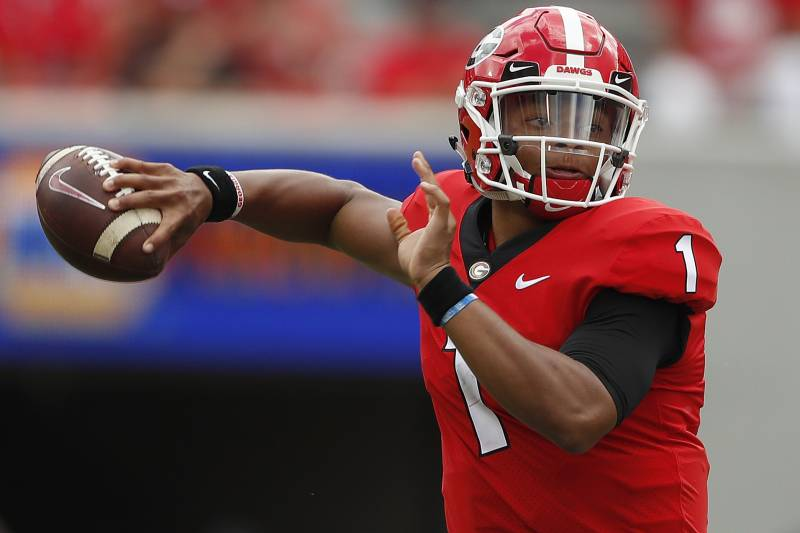 FILE - In this Sept. 15, 2018, file photo, Georgia quarterback Justin Fields (1) throws a pass in the first half of an NCAA college football game against Middle Tennessee, in Athens, Ga. No. 2 Georgia will look for more consistent production than it managed the last two weeks against Missouri and Tennessee when it puts its perfect record on the line against Vanderbilt on Saturday night. (AP Photo/John Bazemore, File)
