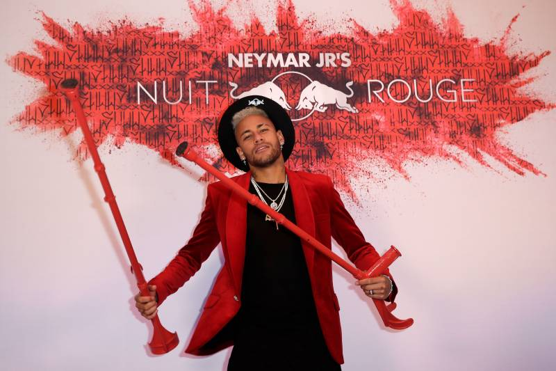 a46eff79e64 Paris Saint-Germain s Brazilian forward Neymar poses with his crutches as  he arrives at his