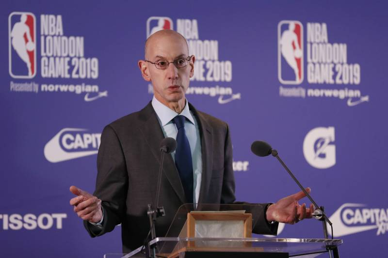 NBA commissioner Adam Silver gestures during a news conference prior to the start of an NBA basketball game between New York Knicks and Washington Wizards at the O2 Arena, in London, Thursday, Jan.17, 2019. (AP Photo/Alastair Grant)