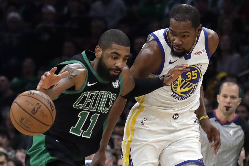 0e46eeba4afe Boston Celtics guard Kyrie Irving (11) dribbles against Golden State  Warriors forward Kevin Durant