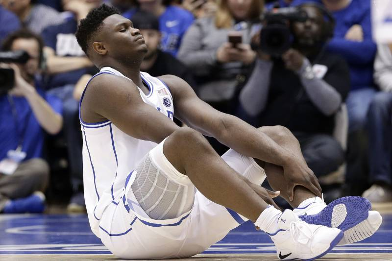 16263ea9af1 Duke s Zion Williamson sits on the floor following a injury during the  first half of an