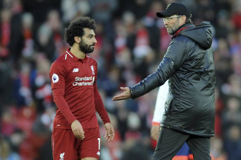 e1389d13e Liverpool manager Juergen Klopp, right, greets Liverpool's Mohamed Salah at  the end of the