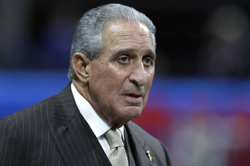 Atlanta Falcons owner Arthur Blank walks on the field before the NFL Super Bowl 53 football game between the Los Angeles Rams and the New England Patriots Sunday, Feb. 3, 2019, in Atlanta (AP Photo/Carolyn Kaster)