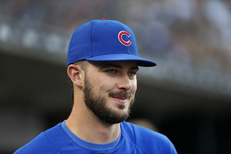 bdd218bc33c61 Chicago Cubs  Kris Bryant smiles in the dugout in the third inning of a  baseball