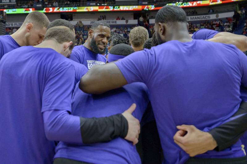 3f13e6c457d7 Los Angeles Lakers forward LeBron James (23) talks to the team before the  first
