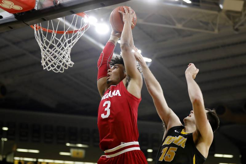 Indiana forward Justin Smith (3) drives to the basket past Iowa forward Ryan Kriener during the first half of an NCAA college basketball game Friday, Feb. 22, 2019, in Iowa City, Iowa. (AP Photo/Charlie Neibergall)