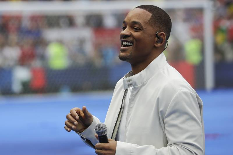 FILE - In this July 15, 2018, file photo, singer and actor Will Smith performs during the closing ceremony prior to the final match between France and Croatia at the 2018 soccer World Cup in the Luzhniki Stadium in Moscow, Russia. The star on Wednesday, Oct. 10, revealed the first poster of Disney's remake of